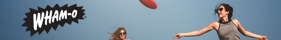 wham-o - an attractive girl throws a frisbee and her friend smiling next to her against a blue sky