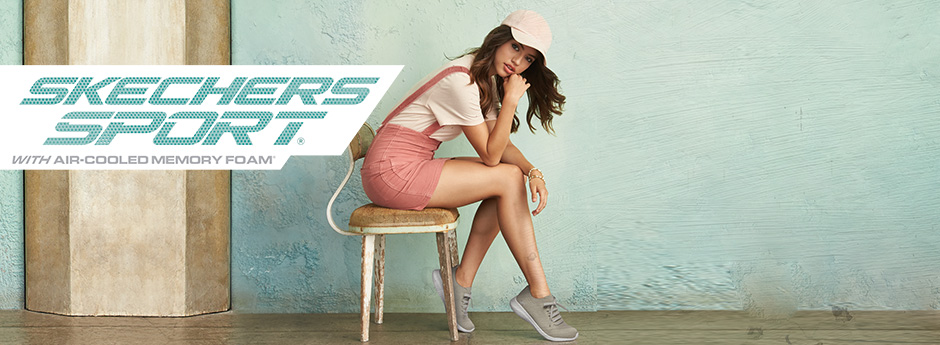 Skechers - Woman sits and poses in Skechers shoes