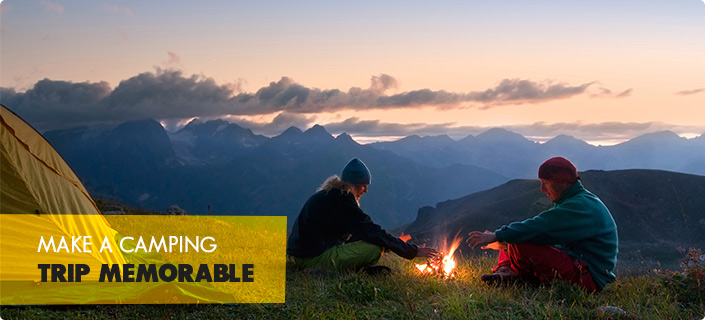 Make A Camping Trip Memorable - an image of a couple warming their hands from a campfire