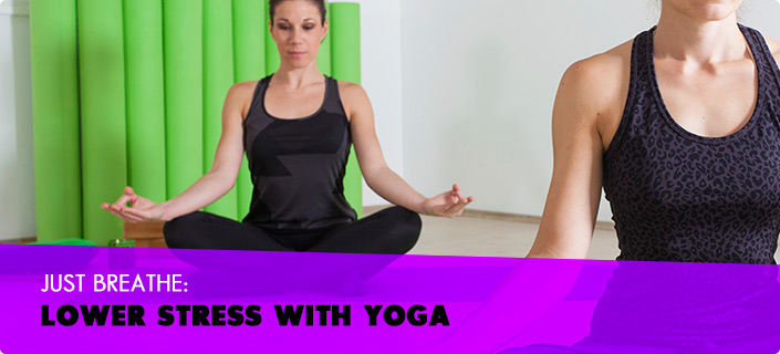 Just Breathe Lower Stress with Yoga - a women wearing black athletic shirt and bottoms sitting indian style with her hands resting on her knees